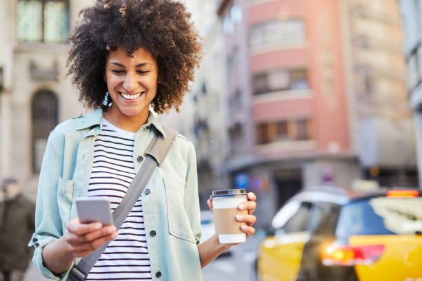 Young hipster woman in the streets of Barcelona commuting. stock photo
