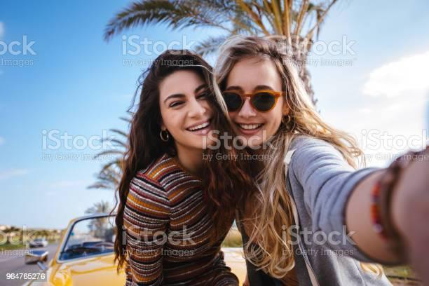 Young hipster women on road trip having fun taking selfies picture id964765276?b=1&k=6&m=964765276&s=612x612&h=trbiajvfzavbfmd erqacgp6csshkasmwosfmjq u i=