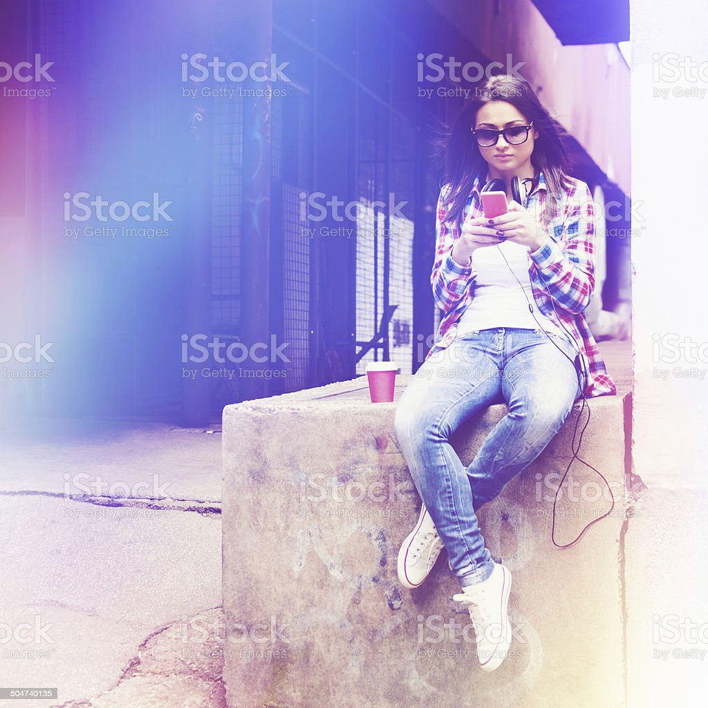 Young hipter woman with smart phone and takeaway coffee stock photo