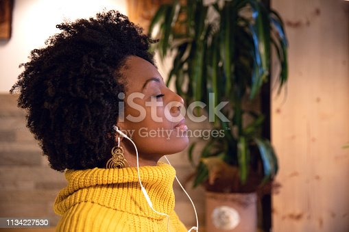 Young hispanic brazilian woman in a cafe in Italy
