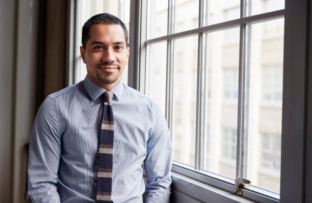 Young Hispanic business man smiling to camera stock photo