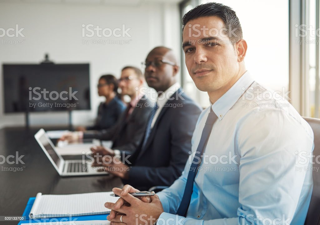 Young Hispanic businessman in a meeting stock photo