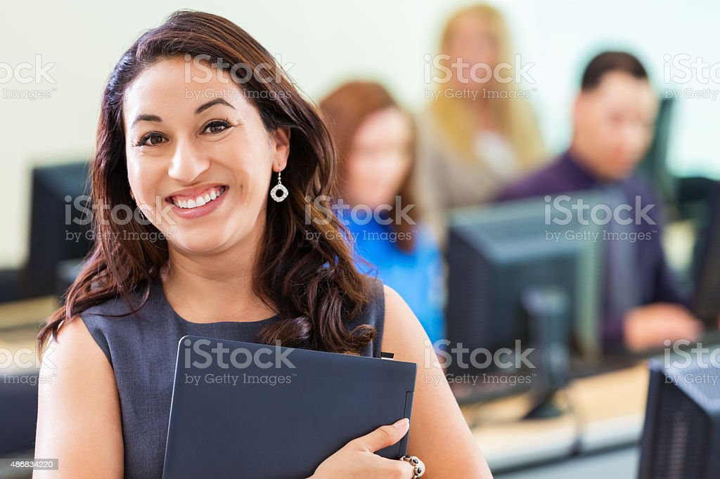 Young Hispanic businesswoman taking job training computer course stock photo