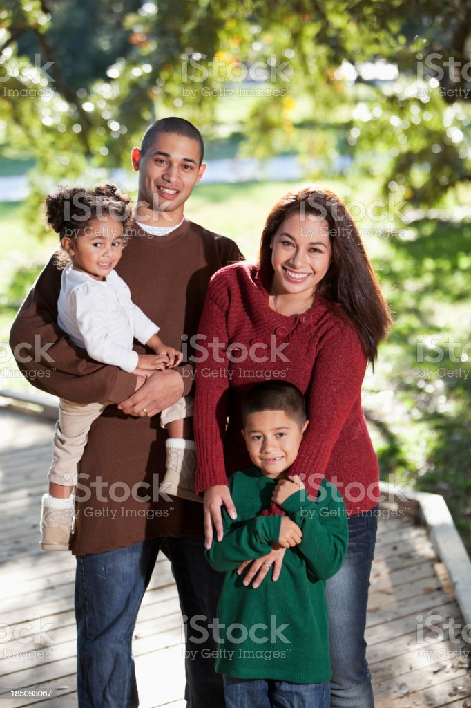 Young hispanic family at park royalty-free stock photo