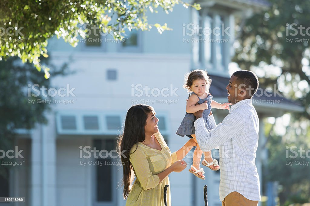 Young Hispanic family outdoors royalty-free stock photo