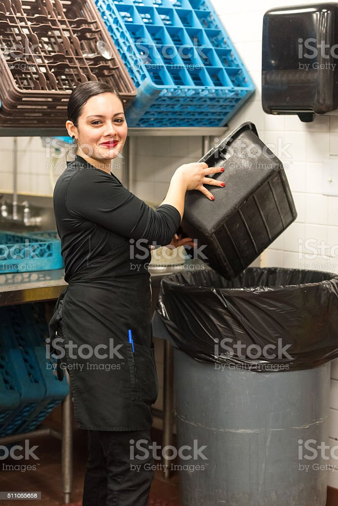 Young hispanic female kitchen worker stock photo