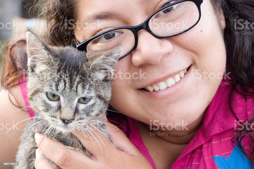 Young Hispanic Female Vet Holding a Kitten royalty-free stock photo