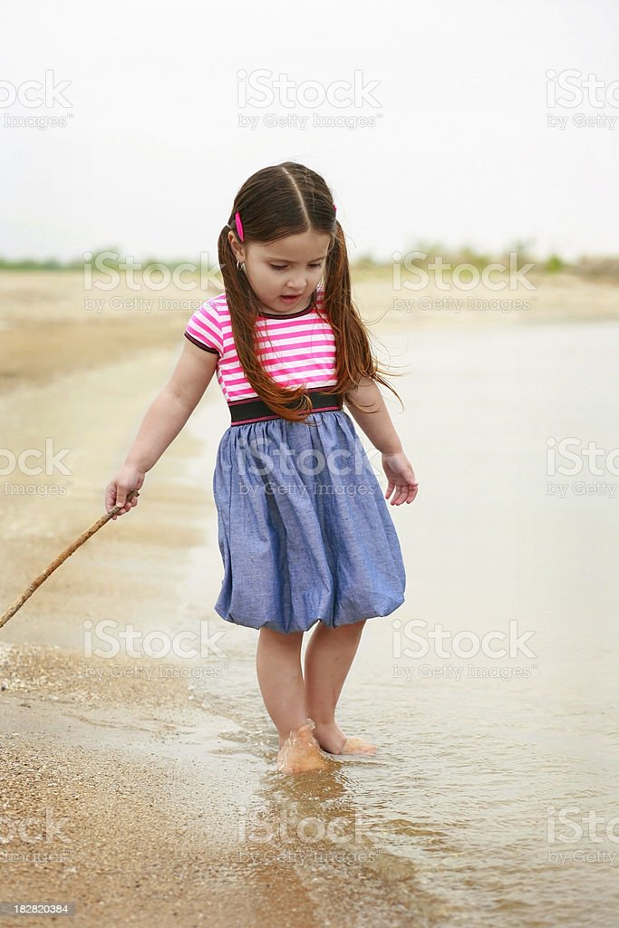 Young Hispanic Girl Walking on the Beach stock photo