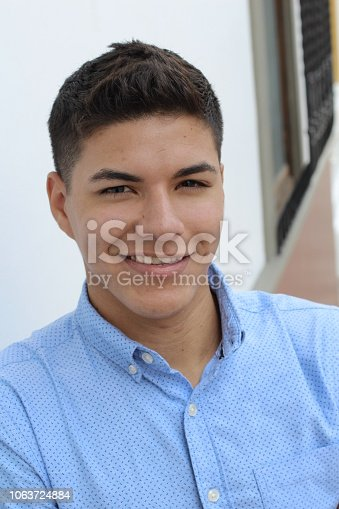 868483314 istock photo Young hispanic male wearing blue button up 1063724884