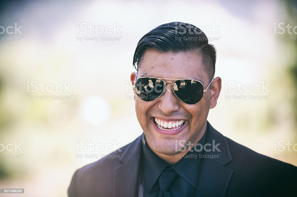 Young Hispanic Man excited and laughing foto stock royalty-free