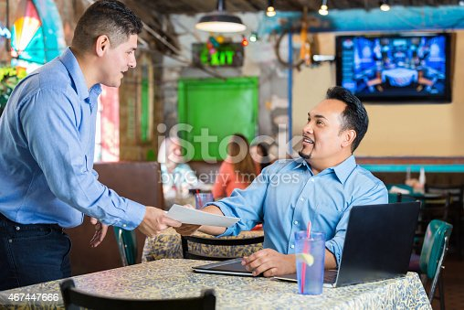 young hispanic man presenting resume during interview with