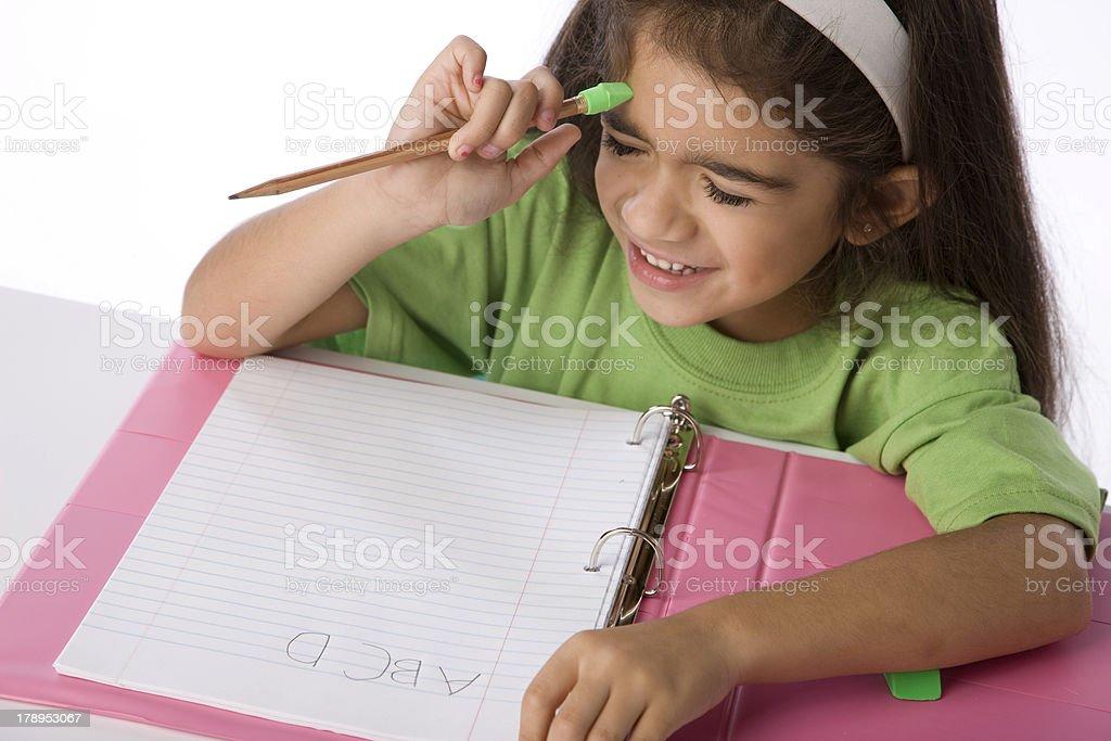 Young HIspanic School Girl Thinks Hard royalty-free stock photo