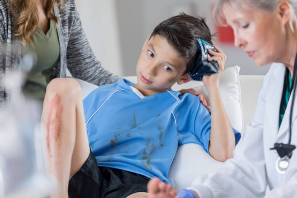 young hispanic soccer player in the emergency room - head injury stock photos and pictures