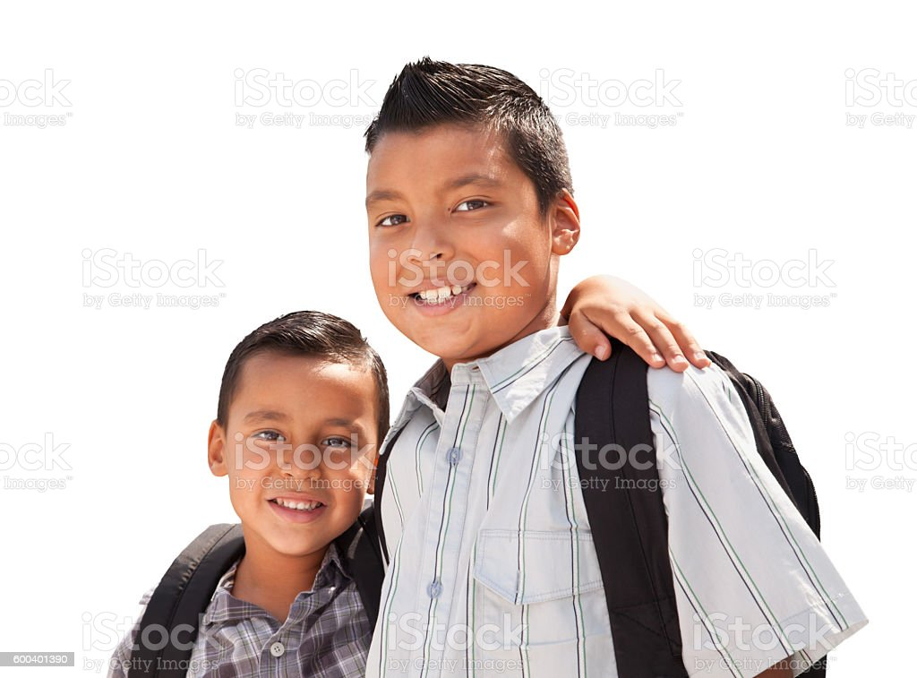 Young Hispanic Student Brothers Wearing Backpacks on White stock photo