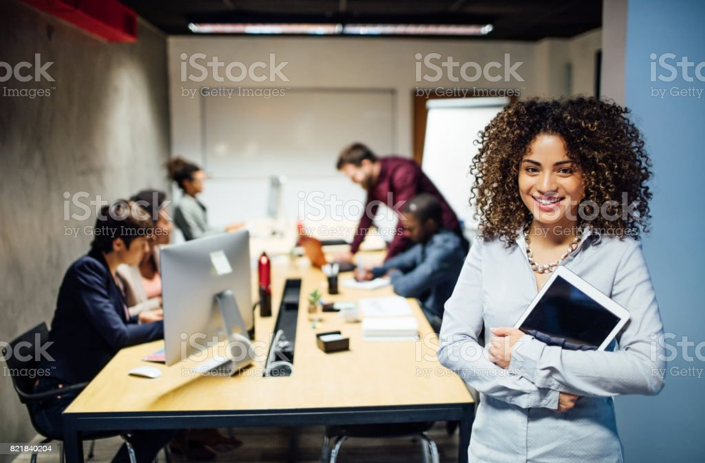 Young hispanic woman at startup stock photo