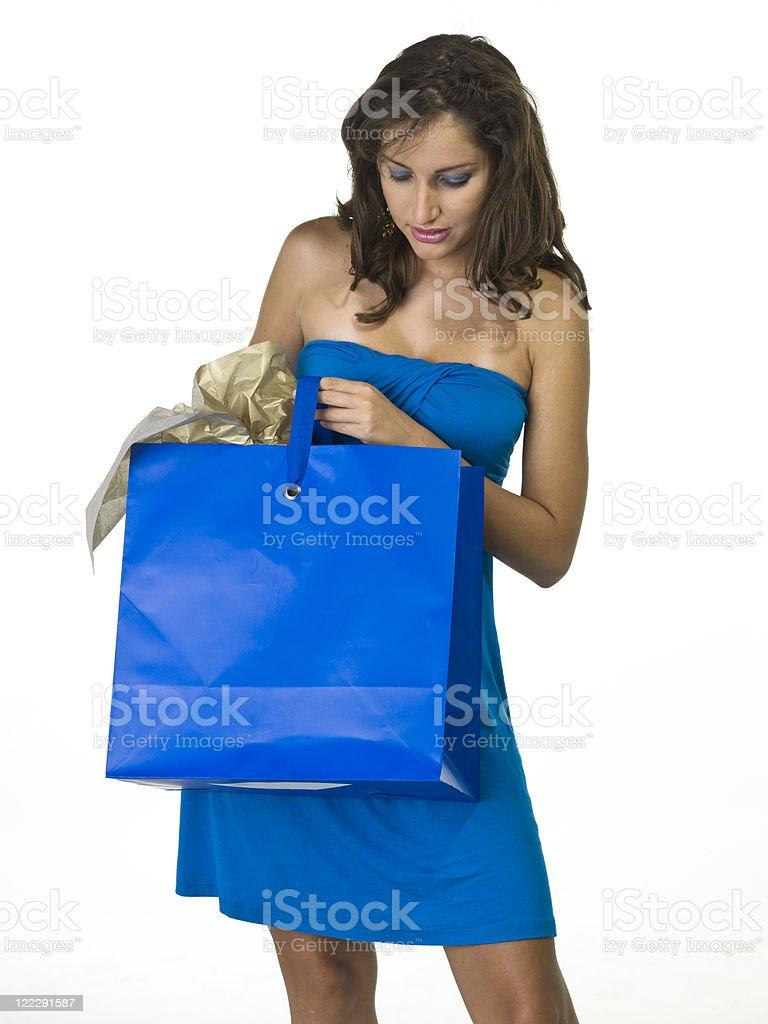 Young hispanic woman checking her shopping bag royalty-free stock photo