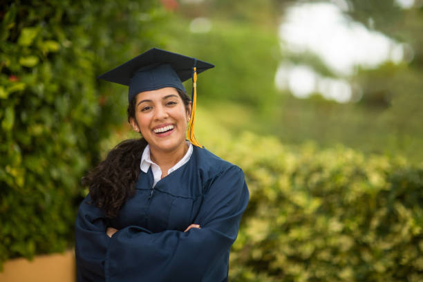 Young Hispanic woman graduating stock photo