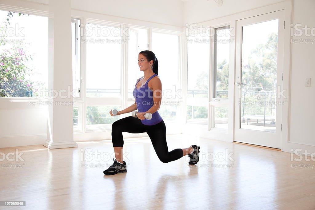 Young Hispanic Woman Lifting Weights stock photo