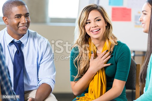 istock Young Hispanic woman participates in support group 506846176