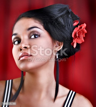 807419930 istock photo Young Hispanic Woman With Flower in Hair Posing 108203230