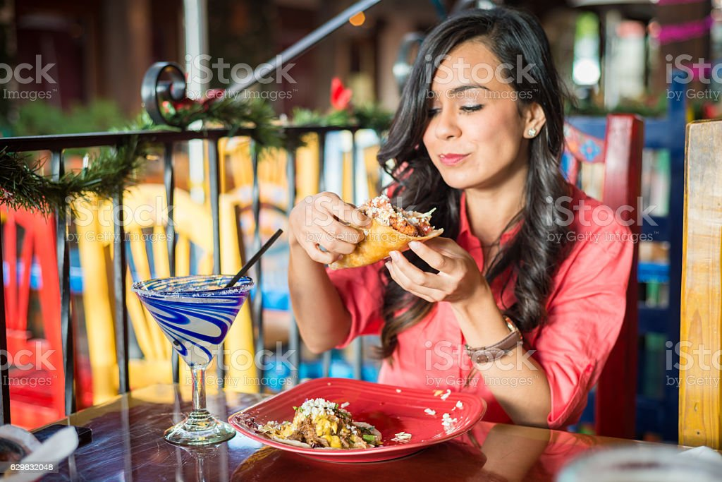Young Hispanic Women At Mexican Restaurant stock photo
