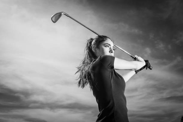 young hispanic women golfer ready to hit - female golfer stock photos and pictures