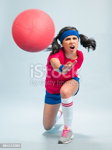 Young Hispanic Women Playing Dodgeball in a retro gym outfit on a white background.