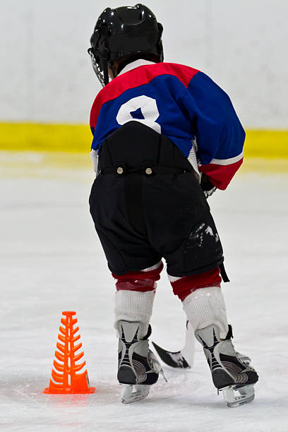 Young hockey player at practice stock photo