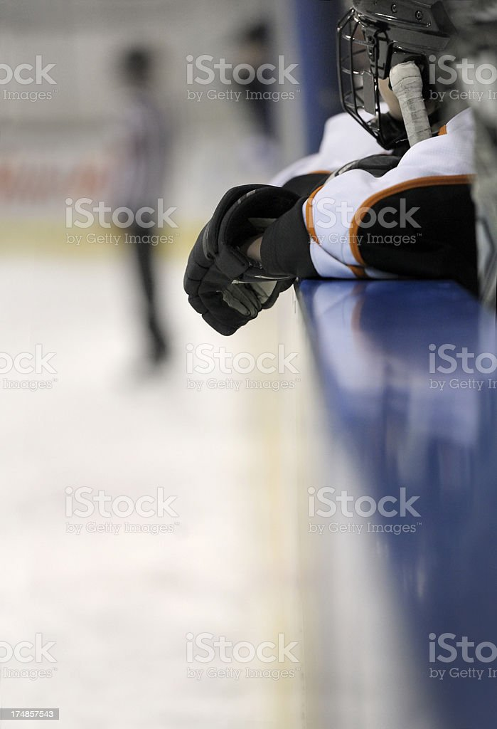 Young hockey player waiting on the bench stock photo