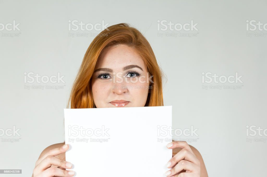 Young holding board for caption space. stock photo