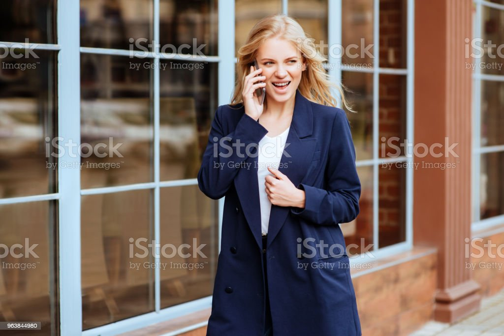 Young holding her Mobile Phone at the City Street - Royalty-free 20-29 Years Stock Photo