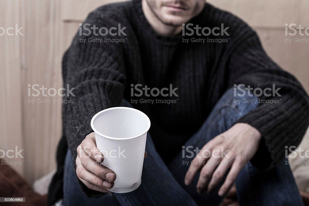 Young homeless man asks for help stock photo