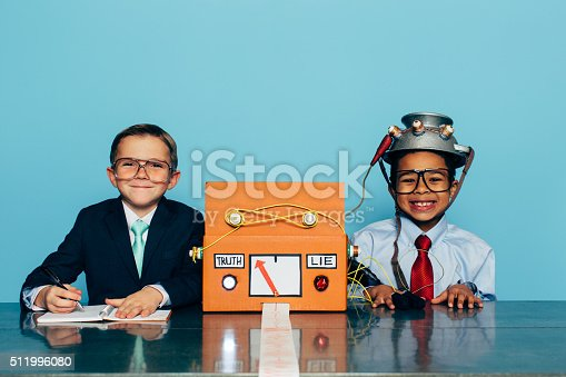 istock Young Honest Businessman is Tested with Lie Detector 511996080