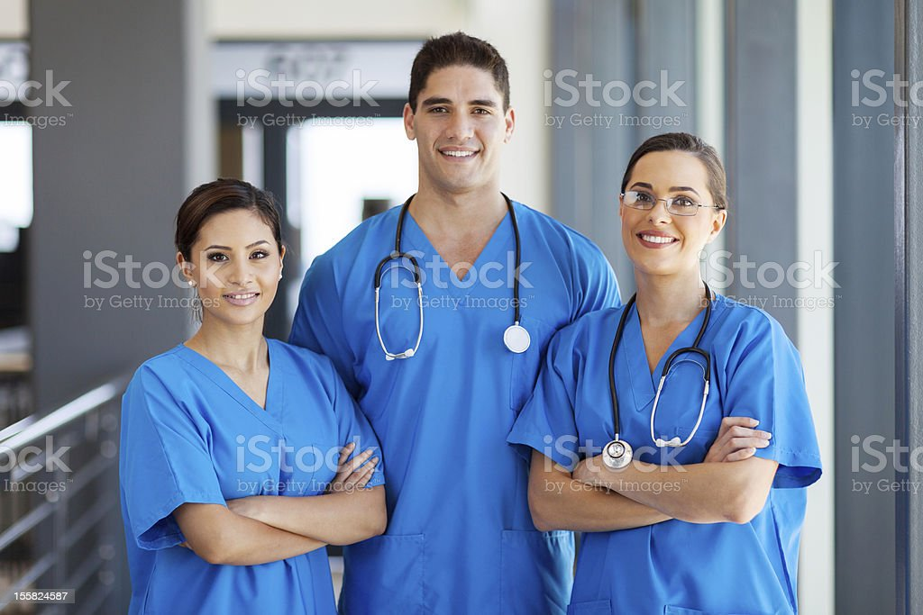 young hospital workers in scrubs stock photo