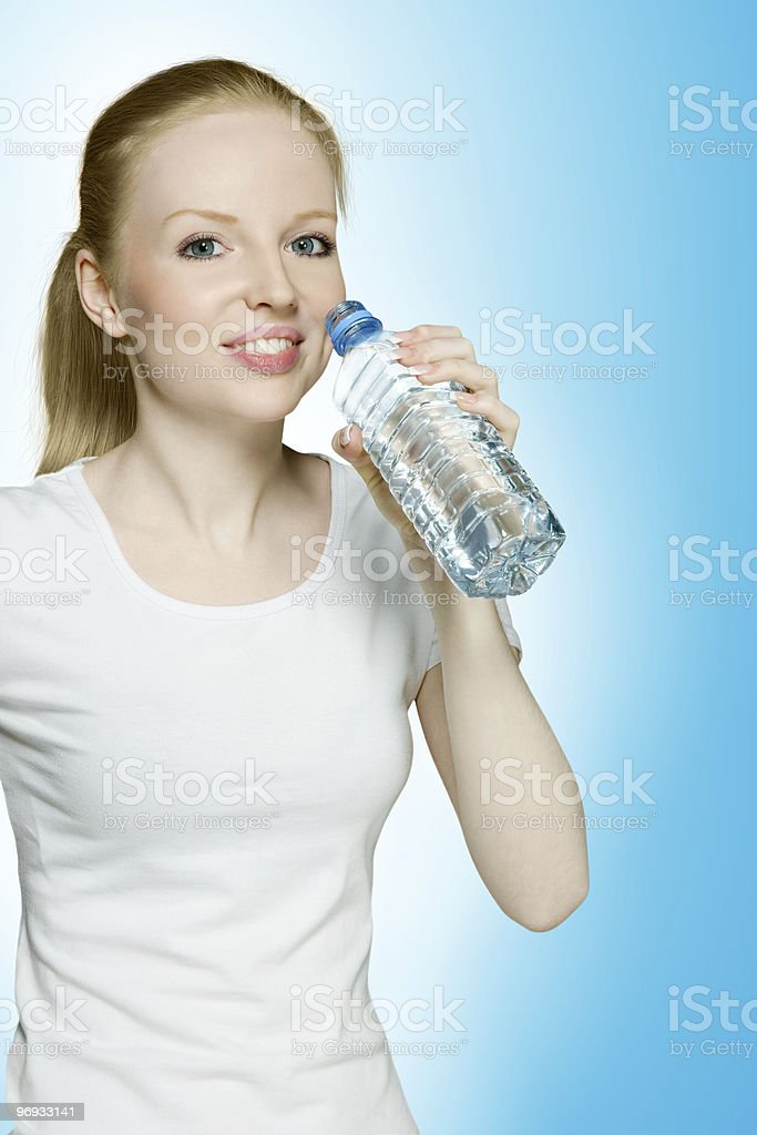 Young hot girl drinking water royalty-free stock photo