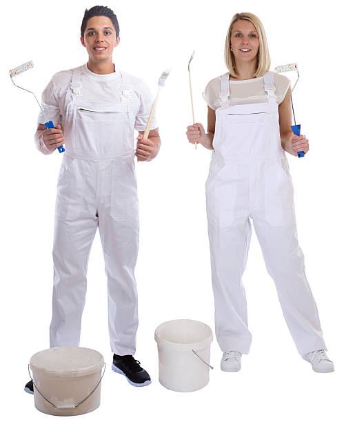 Young house painters decorators apprentice trainees paint bucket stock photo