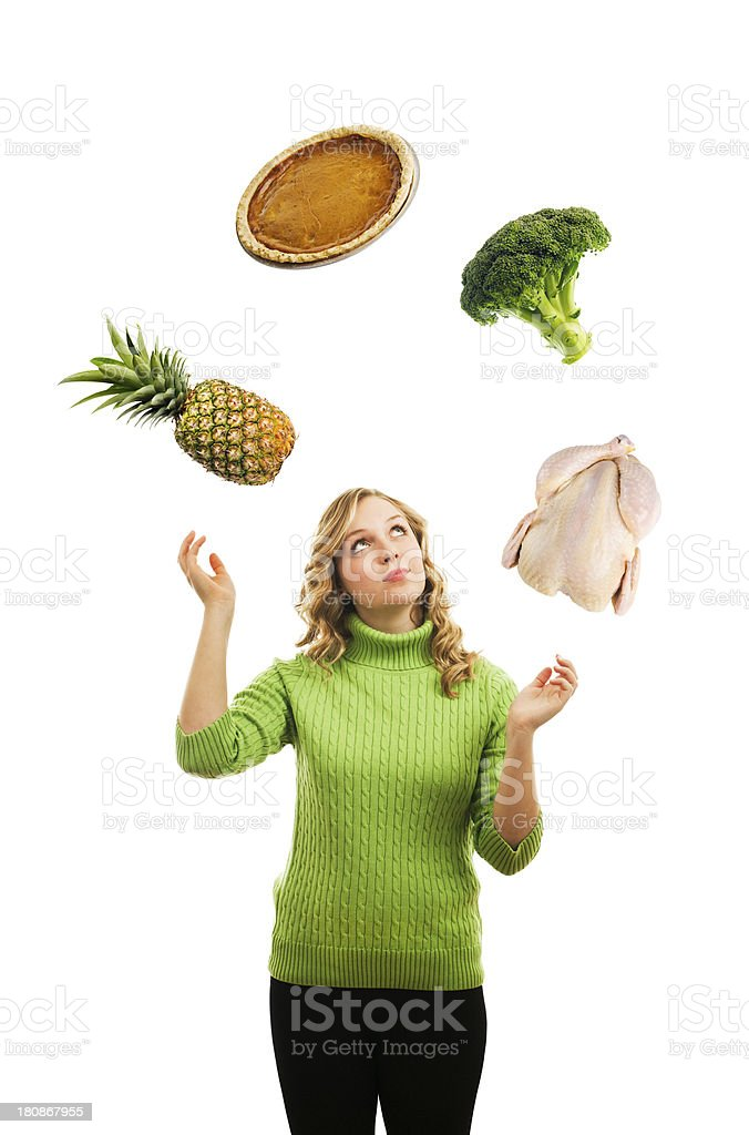 Young Housewife Juggling Meals, Menu, and Nutrient for Family stock photo