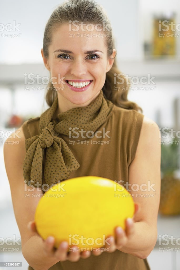 Young Housewife Showing Melon Stock Photo Download Image