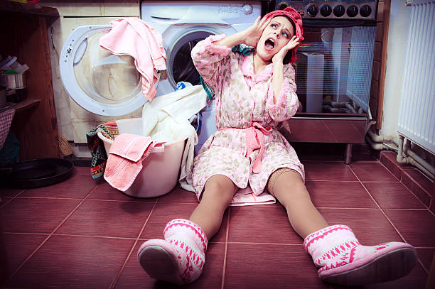 young housewife with washing machine and towels. stock photo