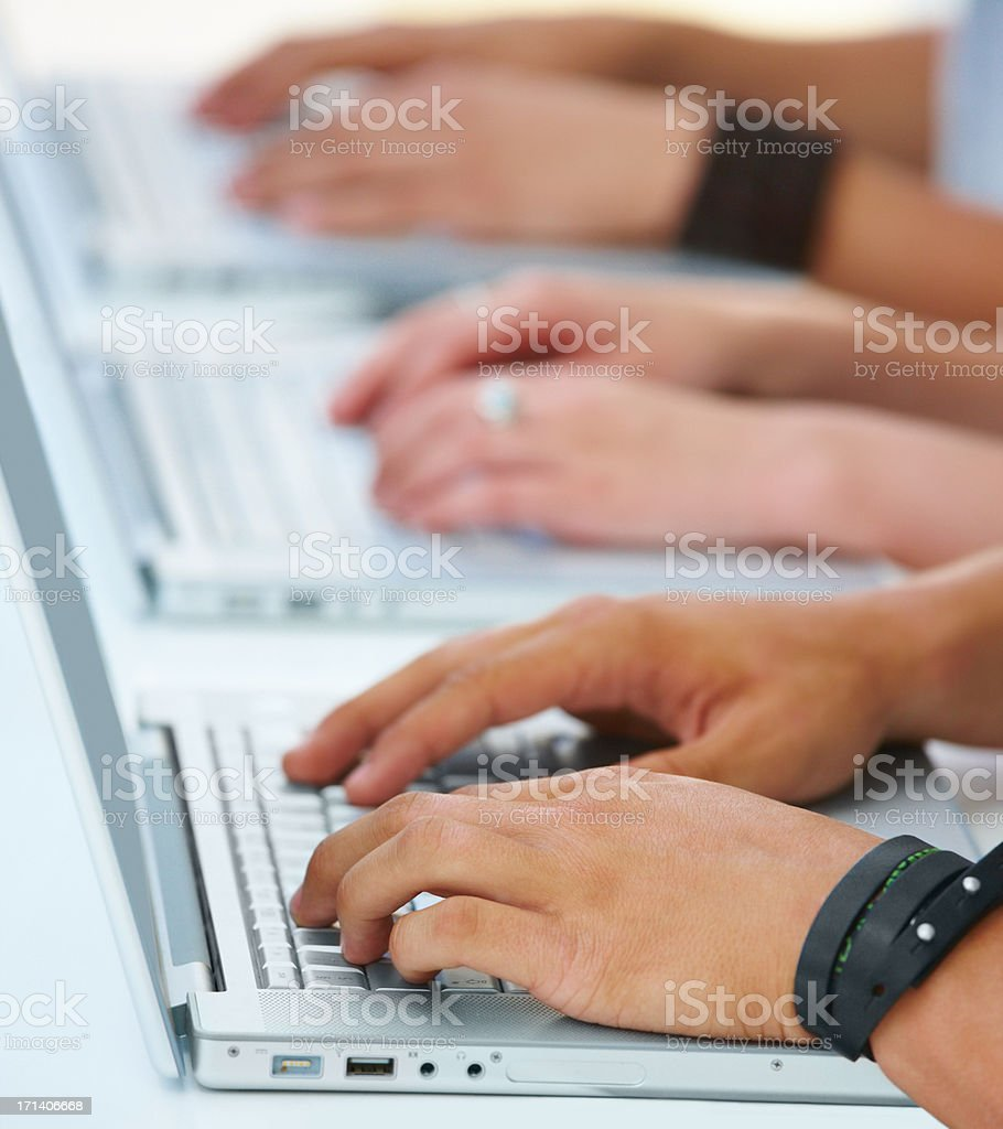Young Human hands operating laptop royalty-free stock photo