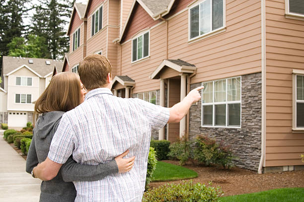 young husband and wife house shopping stock photo