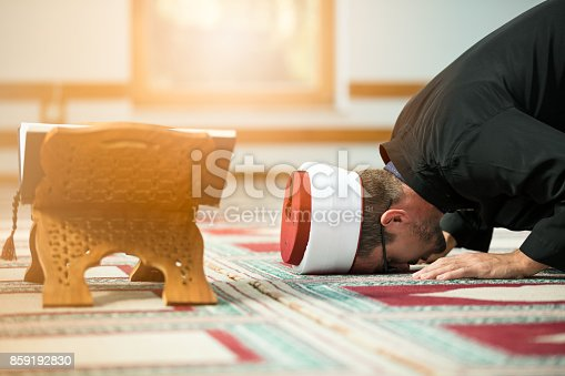 istock Young Imam praying inside of beautiful mosque 859192830