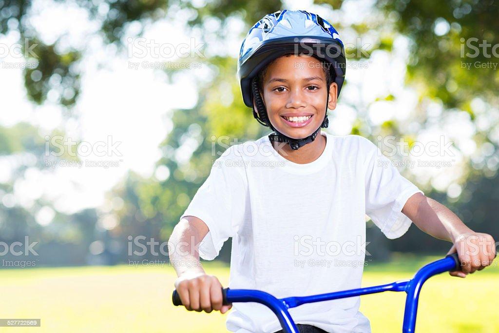 young indian boy riding a bike stock photo