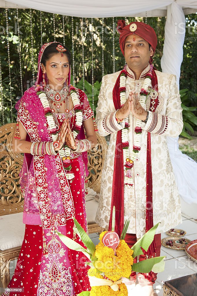 Young Indian bridal couple at traditional wedding ceremony stock photo