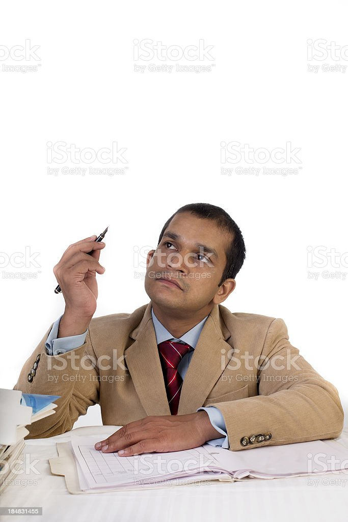 Young Indian businessman thinking. royalty-free stock photo