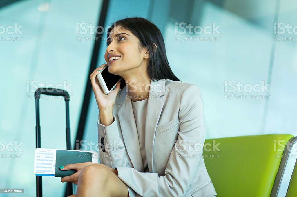 young indian businesswoman talking on cell phone stock photo