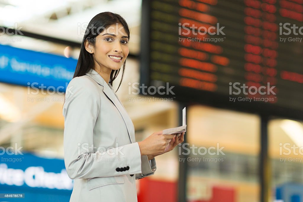 young indian businesswoman travelling by air stock photo