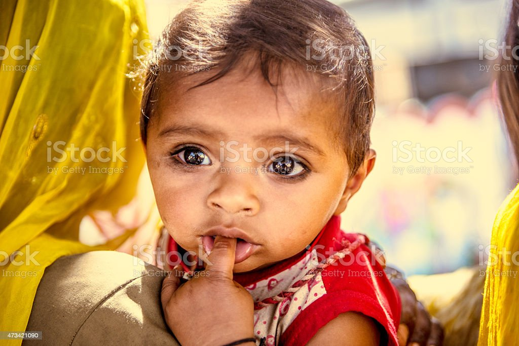 Young Indian child with mother stock photo