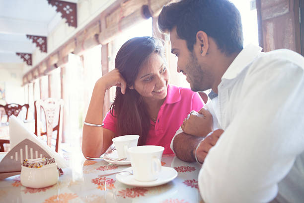 Young Indian Couple on a Date Attractive young Indian couple on a date. romance stock pictures, royalty-free photos & images