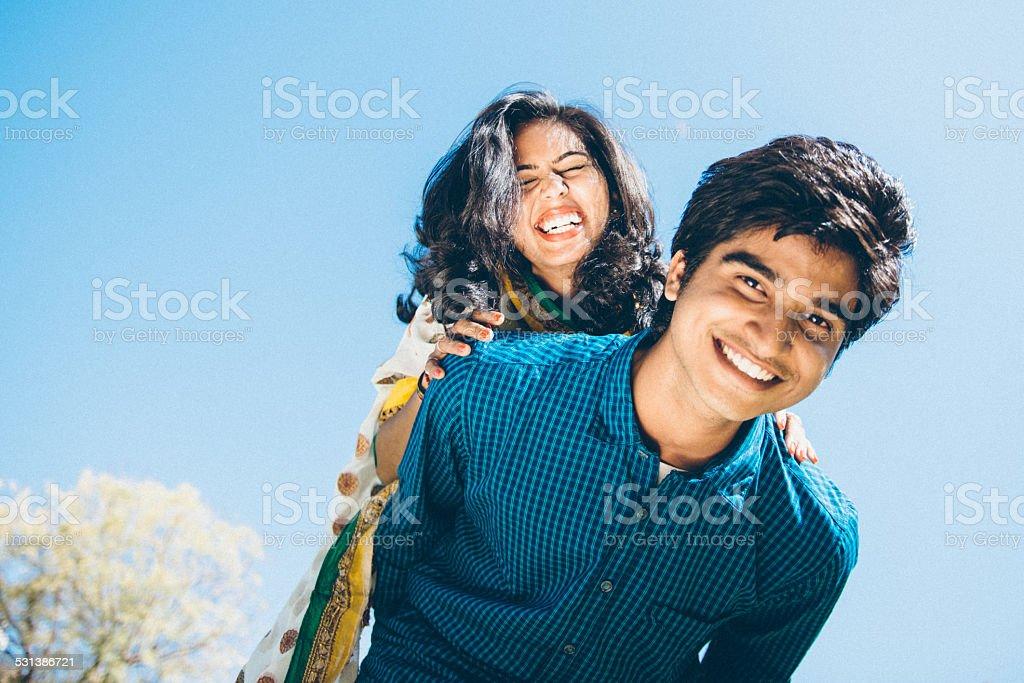 Young Indian couple Piggyback stock photo